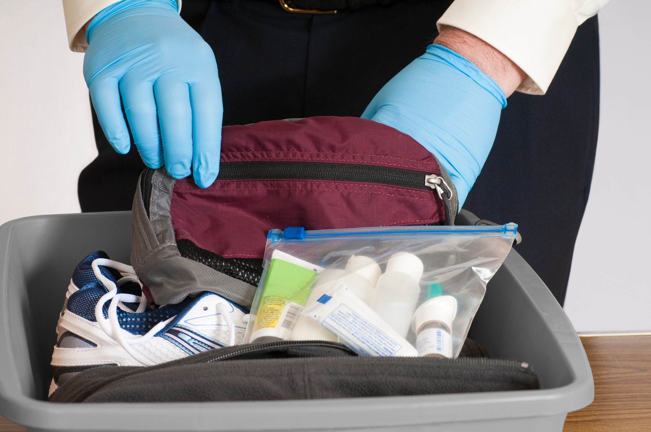1540424245373_iStock-airport-baggage-search.jpg